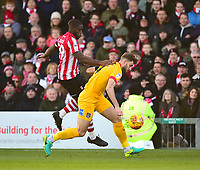 Lincoln City's John Akinde vies for possession with  Northampton Town's Charlie Goode<br /> <br /> Photographer Andrew Vaughan/CameraSport<br /> <br /> The EFL Sky Bet League Two - Lincoln City v Northampton Town - Saturday 9th February 2019 - Sincil Bank - Lincoln<br /> <br /> World Copyright © 2019 CameraSport. All rights reserved. 43 Linden Ave. Countesthorpe. Leicester. England. LE8 5PG - Tel: +44 (0) 116 277 4147 - admin@camerasport.com - www.camerasport.com