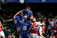 Gary Cahill of Chelsea © heads the ball away.  Premier league match, Chelsea v Arsenal at Stamford Bridge in London on Sunday 17th September 2017.<br /> pic by Kieran Clarke, Andrew Orchard sports photography.