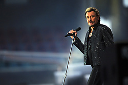 File photo : Johnny Hallyday performs during a concert in Felix Bollaert Stadium in Lens near Lille, north of France on june 9th, 2009. France's biggest rock star Johnny Hallyday has died from lung cancer, his wife says. He was 74. The singer - real name Jean-Philippe Smet - sold about 100 million records and starred in a number of films. Photo by STR/ASA-PICTURES/ABACAPRESS.COM
