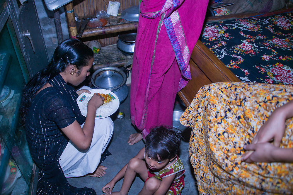 Jalal's daughter comes home form the garment factory for lunch every day. She is the first to eat because she is on a schedule.