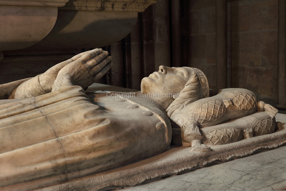 Effigy of Philip, 1396-1420, comte de Vertus, made 1504, on the funerary monument of the Dukes of Orleans, marble, 16th century, with effigies of Louis, Duke of Orleans, 1372-1407, Valentine Visconti his wife, 1366-1408, and their sons Charles the Poet, 1394-1465, and Philip, 1396-1420, comte de Vertus, in the Chapelle Saint-Michel, in the Basilique Saint-Denis, Paris, France. Statuettes of 24 saints and apostles stand in niches around the tomb, which was commissioned in 1502 by Louis XII and made by Italian artists. This tomb was originally in the Chapelle des Celestins in Paris. The basilica is a large medieval 12th century Gothic abbey church and burial site of French kings from 10th - 18th centuries. Picture by Manuel Cohen