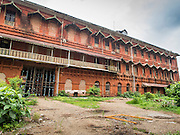 07 JUNE 2014 - YANGON, MYANMAR: The old railway headquarters in Yangon is closed. The complex is slated for redevelopment as a luxury hotel. Yangon has the highest concentration of colonial style buildings still standing in Asia. Efforts are being made to preserve the buildings but many are in poor condition and not salvageable.    PHOTO BY JACK KURTZ