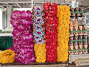09 OCTOBER 2009 -- BANGKOK, THAILAND: Flower garlands for sale at the Erawan Shrine in Bangkok, Thailand. The Erawan Shrine was built in 1954 to facilitate construction on what was then Bangkok's finest hotel. The shrine is seen as a harbinger of commercial success and is packed with Thais visiting to shrine to pray for material success.  The PHOTO BY JACK KURTZ