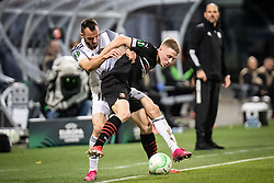 Ziga Kous of NS Mura and Adrien Truffert of Rennes during football match between NS Mura and Rennes (FRA) in group stage of UEFA Europa Conference League 2021/22, on 20 of October, 2021 in Ljudski Vrt, Maribor, Slovenia. Photo by Blaž Weindorfer / Sportida
