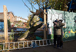 © Licensed to London News Pictures; 02/11/2020; Bristol, UK. Two campaigners for the Save The M32 Maples Campaign embrace this morning after contractors working for a developer from 6am have cut down 2 of the 3 maple trees where the campaigners had built tree houses to protect the 3 remaining Norway Maple trees on Lower Ashley Road in the St Pauls area of Bristol close to the M32 motorway. Several people from the campaign are occupying the remaining tree and tree house. The campaign wanted the trees kept to enhance the environment and help remove pollution in what is a traffic congested area. The campaign asked the police Serious Fraud Unit to investigate allegations of a fraudulent Bristol City Council giveaway of £500,000 of public property, including the trees. Campaigners have obtained documents which show the mature trees fall outside the boundary of the land on Lower Ashley Road owned by John Garlick, and they claim the strip of land the three remaining protected trees are on belongs to Bristol City Council's highways department. Bristol City Council denies the claim and says the existing maps are inaccurate and that the trees are not on council owned land as it was all sold off by the council. Two of five trees originally there were felled on New Year's Eve, and campaigners chained themselves to remaining trees to prevent them being cut down. Photo credit: Simon Chapman/LNP.