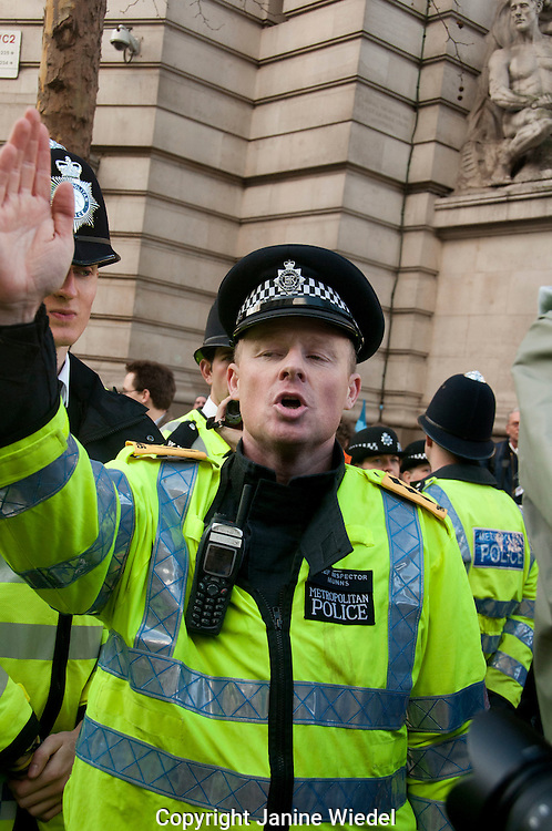 Policeman directing a protest march through London