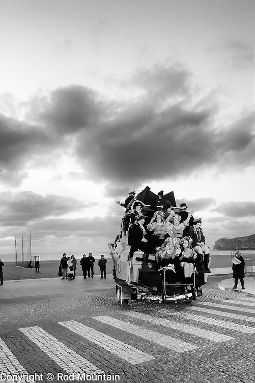 Nazaré, Portugal - February 12, 2018 - Nazaré Festival 06 - Carnaval is celebrated in Nazare and throughout Portugal. Costumed parades and plenty of music! <br /> <br /> Image: © Rod Mountain<br /> http://www.rodmountain.com<br /> <br /> Nikon D800 / Nikkor Lens<br /> @nikoncanada #NikonCA<br /> @NikonUSA #NikonNoFilter<br /> @nikoneurope #NikonEurope<br /> #turismoemportugal #turismo #rotaportugal <br /> #awesomebnw #folkgood #traveldeeper #tourism #worldcaptures #justgoshoot #TheGlobeWanderer #everydayportugal #travelblog#instago #ourstreets #carnaval #blackandwhite #blackandwhitephotography<br /> #bwmasters #blacknwhitepic #bnw_captures #bnw_universe #bwsquare #FriendsinBNW #friendsinstreets #featuremeinstagood #travelblog#instago<br /> <br /> https://en.wikipedia.org/wiki/Nazaré,_Portugal<br /> http://www.cm-nazare.pt/en<br /> https://en.wikipedia.org/wiki/Carnival <br /> https://en.wikipedia.org/wiki/Portugal http://bit.ly/Nazaré_bw<br /> http://bit.ly/Nazare_Portugal https://www.visitportugal.com/en<br /> @visitportugal