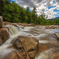 New England waterfall photography of Lower Falls in the White Mountain National Forest of New Hampshire. This set of cascades and waterfalls is easily accessbile from a parking are along the Kancamagus Highwal in Albany, NH.<br /> <br /> New Hampshire White Mountain National Forest waterfall fine art photography artworks are available as museum quality photography prints, canvas prints, acrylic prints, wood prints or metal prints. Fine art prints may be framed and matted to the individual liking and interior design decorating needs.<br /> <br /> Good light and happy photo making!<br /> <br /> My best,<br /> <br /> Juergen
