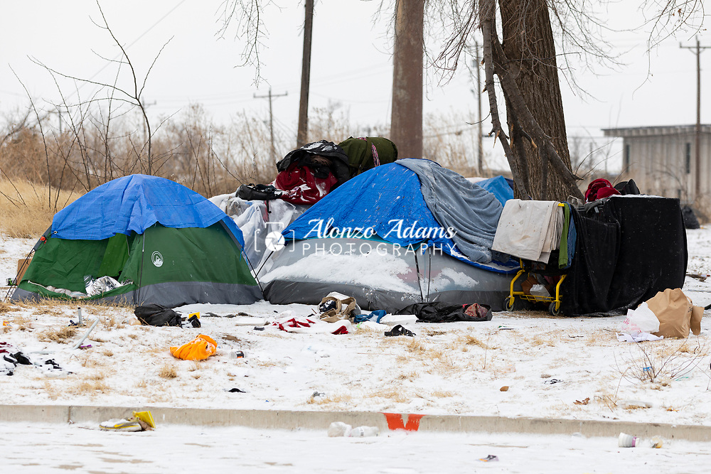 Homeless stay in tents at Western Ave. and Oklahoma City Blvd. during freezing cold temperatures and snow in Oklahoma City on Friday, February 12, 2021. Photo copyright © 2021 Alonzo J. Adams