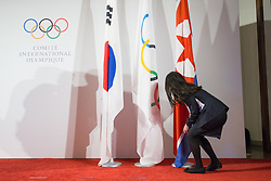 LAUSANNE, Jan. 20, 2018  A staff member of the International Olympic Committee (IOC) headquarters arranges the flags for welcoming the delegations of the Democratic People's Republic of Korea (DPRK) and South Korea in Lausanne, Switzerland, January 20, 2018. (Credit Image: © Xu Jinquan/Xinhua via ZUMA Wire)