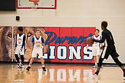 The 7th grade basketball team at Durant Middle School plays a game in Durant, Oklahoma on January 27, 2017.  (Cooper Neill for The New York Times)