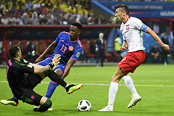 June 25, 2018 - Kazan, Russia - Robert Lewandowski of Poland fights for the ball with David Ospina and Yerry Mina of Colombia during the 2018 FIFA World Cup Group H match between Poland and Colombia at Kazan Arena in Kazan, Russia on June 24, 2018  (Credit Image: © Andrew Surma/NurPhoto via ZUMA Press)