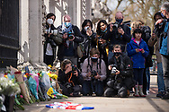 The worlds press in position as members of the public lay flowers In memory of Prince Philip The Royal Highness the Duke of Edinburgh, London on 9 April 2021.