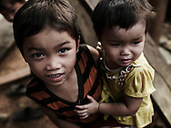 Portrait of two little children. A bother is holding little sister, looking after her. Pu Luong area, Hoa Binh province, Vietnam, Asia.