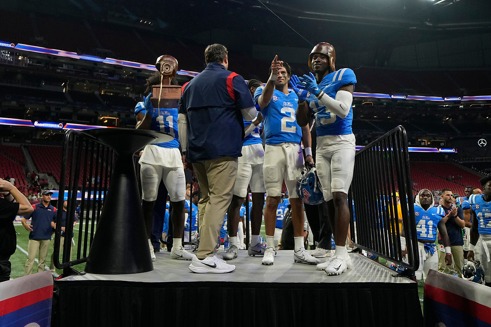 The Mississippi Rebels celebrate winning the 2021 Chick-fil-A Kickoff Game against the Louisville Cardinals, Monday, Sept. 6, 2021, in Atlanta.(Paul Abell via Abell Images for the Chick-fil-A Kickoff Game)