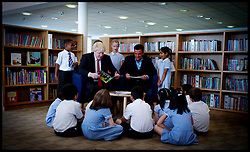 London Mayor Boris Johnson (left) and Peter Andre read to children at Botwell Green Library, London, as the Mayor launches a new reading and literacy project, Tuesday June 14, 2011. Photo by Andrew Parsons/ i-Images