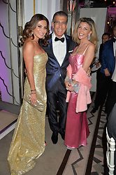 Left to right, ELLA KRASNER, STEVE VORSARI and LISA TCHENGUIZ at the QBF Spring Gala in aid of the Red Cross War Memorial Children's Hospital hosted by Heather Kerzner and Jeanette Calliva at Claridge's, Brook Street, London on 12th May 2015.