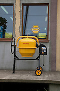 Yellow cement mixer displayed in front of Polish hardware store. Rzeczyca Central Poland