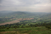 View along a valley in Powys from a high point Wales, UK. The Welsh countryside is incredibly lush and green with rolling hills.