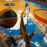 Anadolu Efes's Milko Bjelica (L) during their Turkish Airlines Euroleague Basketball Top 16 Round 13 match Anadolu Efes between EA7 Emporio Armani Milan at Abdi ipekci arena in Istanbul, Turkey, Friday April 03, 2015. Photo by Aykut AKICI/TURKPIX