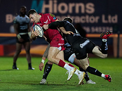 Scarlets' Gareth Davies is tackled by Toulon's Chris Ashton<br /> <br /> Photographer Simon King/Replay Images<br /> <br /> European Rugby Champions Cup Round 6 - Scarlets v Toulon - Saturday 20th January 2018 - Parc Y Scarlets - Llanelli<br /> <br /> World Copyright © Replay Images . All rights reserved. info@replayimages.co.uk - http://replayimages.co.uk