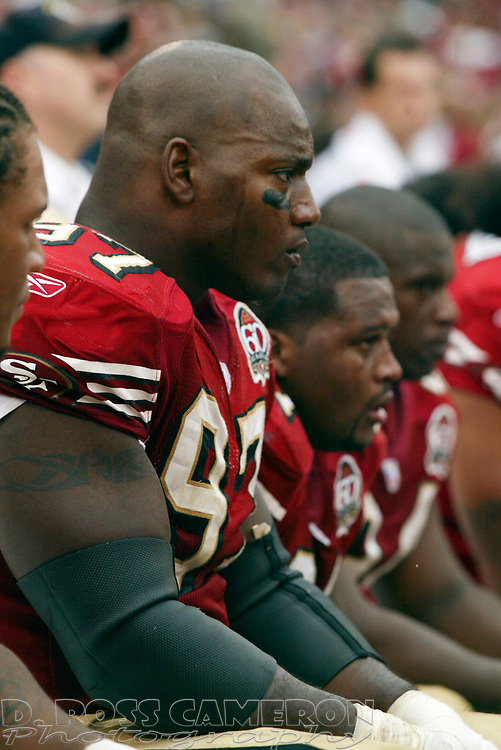 San Francisco 49ers defensive end Bryant Young (97) commiserates on the sidelines during the fourth quarter of an NFL football game against the San Diego Chargers, Sunday, Oct. 15, 2006 at Candlestick Park in San Francisco. The Chargers won, 48-19. (D. Ross Cameron/The Oakland Tribune)