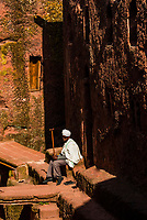 A blind priest sits outside Debre Sina Mikael (Church of St. Michael), one of 11 rock hewn medieval monolithic churches in  Lalibela, Ethiopia.