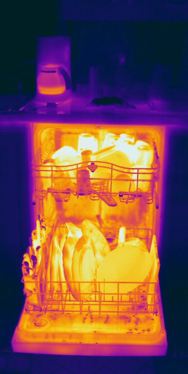 Thermogram of a hot dishwasher and coffee machine.  The different colors represent different temperatures on the object. The lightest colors are the hottest temperatures, while the darker colors represent a cooler temperature.  Thermography uses special cameras that can detect light in the far-infrared range of the electromagnetic spectrum (900?14,000 nanometers or 0.9?14 µm) and creates an  image of the objects temperature..