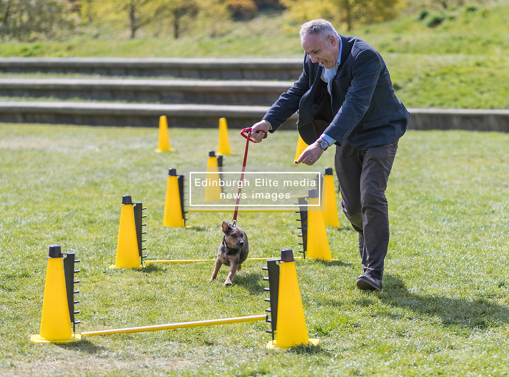 MSPs display their dogs and put them through an agility course with the winner decided by a public vote on the day.<br /> <br /> Pictured: Richard Lochead with his dog Cinder