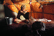 Pouring water over hot rocks to create steam at River's sweat lodge. Shot for a New Age story written by Bernard Zekri for Actuel Magazine?France. Santa Fe, New Mexico, USA..MODEL RELEASED.