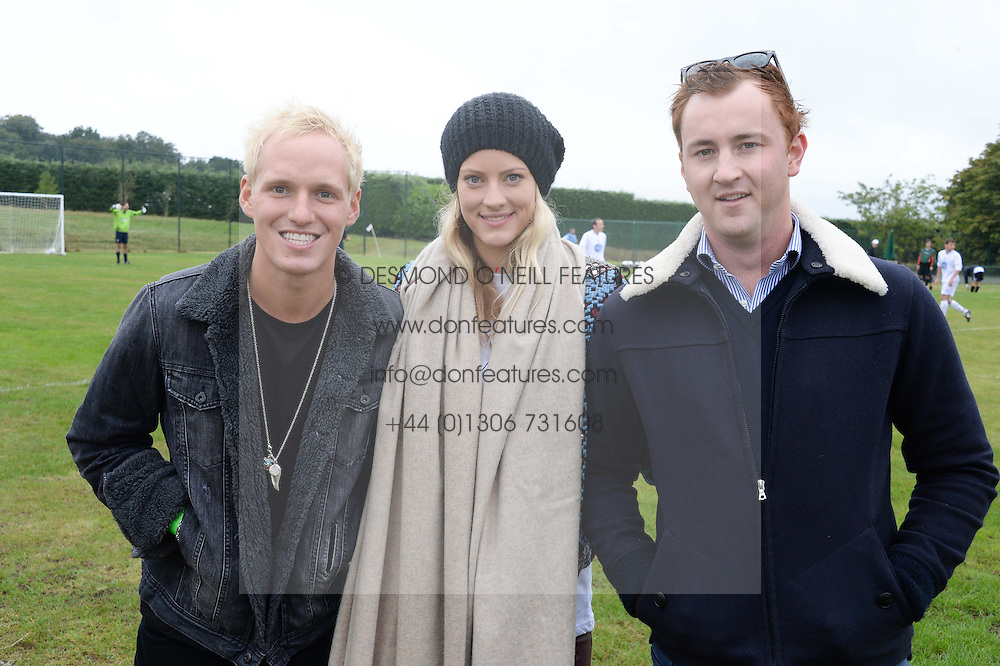 Left to right, JAMIE LAING, CHARLOTTE BAER and FRANCIS BOULE at the Ripley Football Tournament hosted by Irene Forte in aid of The Samaritans held at Ryde Farm, Hungry Hill Lane, Ripley, Surrey on 14th September 2013.  After the football guests enjoyed an after party.