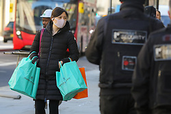 © Licensed to London News Pictures. 16/03/2020. London, UK. A shopper wearing a face mask on Regent Street. 35 coronavirus victims have died and 1,372 have tested positive for the virus in the UK as of 9am on Sunday, 15 March 2020. Photo credit: Dinendra Haria/LNP