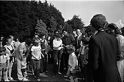15/07/1972<br /> 07/15/1972<br /> 15 July 1972<br /> Muhammad Ali at Stewarts Hospital Fete, Palmerstown, Dublin. Ali signing autographs for young fans.