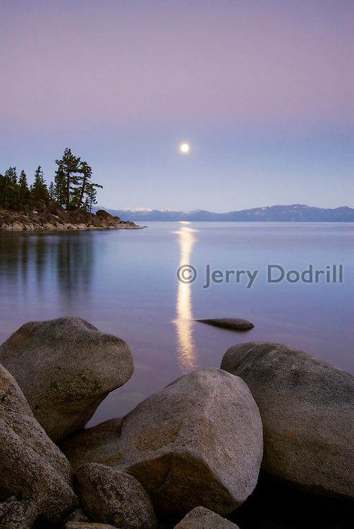 Moonset at dawn, near Memorial Point along Lake Tahoe's NE shoreline. Lake Tahoe is a large freshwater lake in the Sierra Nevada range on the California/Nevada Border. At a surface elevation of 6,225 ft Lake Tahoe is the largest alpine lake in North America with a depth of 1,645 ft.