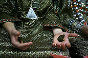 The Henna paste spread on hands of family and friends at the Henna ceremony.  Henna celebration is a traditional oriental jewry ceremony the couple attend one week befor they get married. during the ceremony they wear traditional clothes and jewelry, dance and applying henna paste to the skin for good luck.