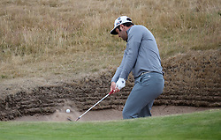 Spain's Jon Rahm chips from a bunker on the 2nd during preview day four of The Open Championship 2018 at Carnoustie Golf Links, Angus. PRESS ASSOCIATION Photo. Picture date: Wednesday July 18, 2018. See PA story GOLF Open. Photo credit should read: Jane Barlow/PA Wire. RESTRICTIONS: Editorial use only. No commercial use. Still image use only. The Open Championship logo and clear link to The Open website (TheOpen.com) to be included on website publishing.