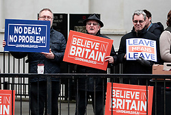 © Licensed to London News Pictures. 10/01/2019. London, UK. Pro-Brexit demonstrators hold placards in Westminster. Politicians are currently debating British Prime Minister Theresa May's Brexit deal for the second time, after the previous vote was postponed. Photo credit : Tom Nicholson/LNP