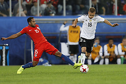 July 3, 2017 - Saint Petersburg, Russia - Jean Beausejour (L) of Chile national team and Joshua Kimmich of Germany national team vie for the ball during FIFA Confederations Cup Russia 2017 final match between Chile and Germany at Saint Petersburg Stadium on July 2, 2017 in Saint Petersburg, Russia. (Credit Image: © Mike Kireev/NurPhoto via ZUMA Press)
