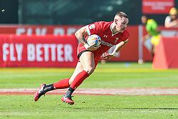 Cameron Lewis of Wales in action<br /> <br /> Photographer Craig Thomas/Replay Images<br /> <br /> World Rugby HSBC World Sevens Series - Day 2 - Friday 6rd December 2019 - Sevens Stadium - Dubai<br /> <br /> World Copyright © Replay Images . All rights reserved. info@replayimages.co.uk - http://replayimages.co.uk