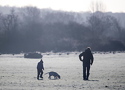 © Licensed to London News Pictures. 16/12/2017. London, UK. A young boy and his father playing with a puppy on frost covered landscape in Richmond Park. Parts of the UK are experiencing freezing temperatures today with snow expected in parts. London, UK. Photo credit: Ben Cawthra/LNP
