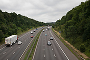 Aerial view of cars and other vehicles on the M42 motorway near Alvechurch, United Kingdom. A controlled-access highway is a type of highway which has been designed for high-speed traffic, and traffic flow. Common English terms are freeway, motorway and expressway. Other similar terms include Interstate and parkway.