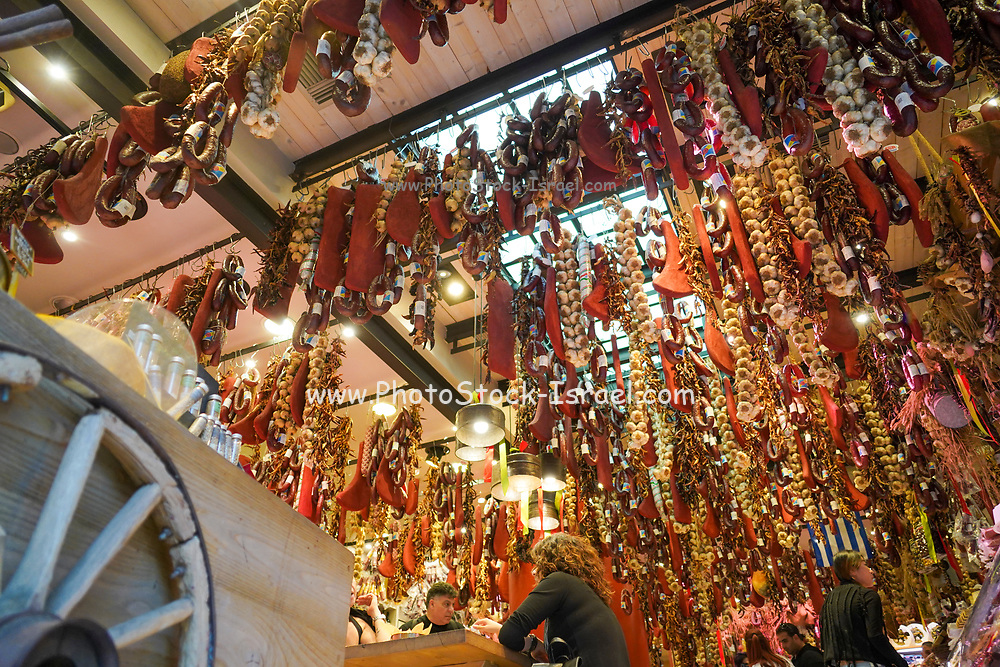 Interior of a delicatessen store in Athens, Greece. Cured and processed meat hangs from the ceiling