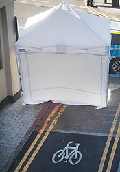© Licensed to London News Pictures. 05/04/2018. London, UK. Blood is seen on the pavement where a police tent covers the murder scene in Hackney after a 20 year old man was stabbed in Link Street. Police were approached by a man suffering from stab injuries at 8pm last night he was pronounced dead at 8. 24pm by officers. Photo credit: Peter Macdiarmid/LNP