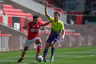 Exeter City's Josh Key (30) appeals for a touch kick as Bristol City's Jay Dasilva (3) dribbles away during the EFL Cup match between Bristol City and Exeter City at Ashton Gate, Bristol, England on 5 September 2020.