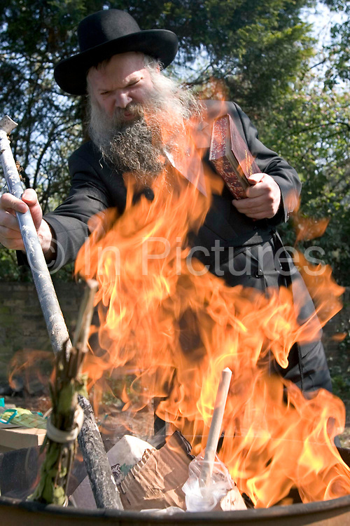 On the first day of Passover Rabbi Gluck burns his homets and the tools used to collect the homets in a garden fire. While burning these items he recites a prayer.