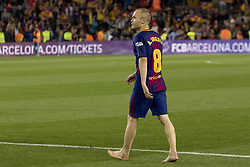 May 6, 2018 - Barcelona, Catalonia, Spain - Andres Iniesta walks barefoot on the grass of the Camp Nou after the spanish football league La Liga match between FC Barcelona and Real Madrid at the Camp Nou Stadium in Barcelona, Catalonia, Spain on May 6, 2018  (Credit Image: © Miquel Llop/NurPhoto via ZUMA Press)