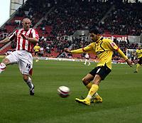 Photo: Mark Stephenson/Sportsbeat Images.<br /> Stoke City v Watford. Coca Cola Championship. 09/12/2007.Watford's Jobi McAnuff crosses the ball with Stokes Stephen Wright