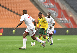 South Africa: Johannesburg: Bafana Bafana player Lebohang Maboe challenges Bertrand Esther of  Seychelles during the Africa Cup Of Nations qualifiers at FNB stadium, Gauteng.<br />Picture: Itumeleng English/African News Agency (ANA)