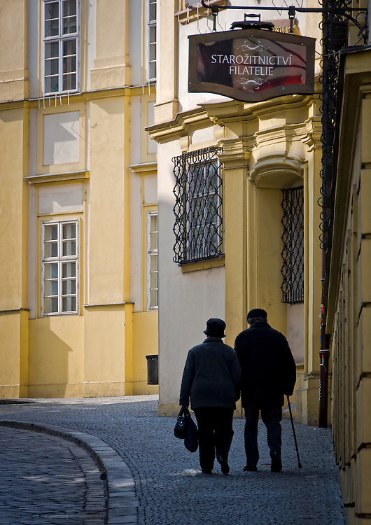 BRNO, CZECH REPUBLIC - MARCH 5th 2011: Old couple walking in Dominikánská Street, in the old town of Brno. Brno is the second largest city in the Czech Republic and Capital of the Moravia Region. This is a very popular tourist destination. EDITORIAL USE ONLY.
