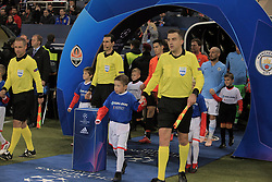 October 23, 2018 - Kharkiv, Ukraine - Referees hit the pitch before the UEFA Champions League Group F Matchday 3 game between FC Shakhtar Donetsk and Manchester City FC at the Metalist Stadium Regional Sports Complex, Kharkiv, northeastern Ukraine, October 23, 2018. Ukrinform. (Credit Image: © Vyacheslav Madiyevskyy/Ukrinform via ZUMA Wire)